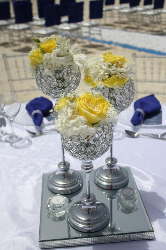 destination wedding, punta cana, dominican republic, la romana, secrets, dreams, now, aavtravel, beach wedding, centerpiece, flowers, yellow, navy blue