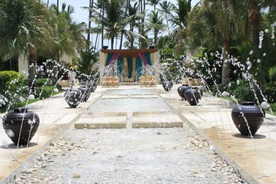 destination wedding, punta cana, dominican republic, la romana, secrets, dreams, now, aavtravel, beach wedding, indian wedding, fountain, walkway, aisle